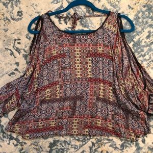 Beautiful flowy shirt with shoulders cut out